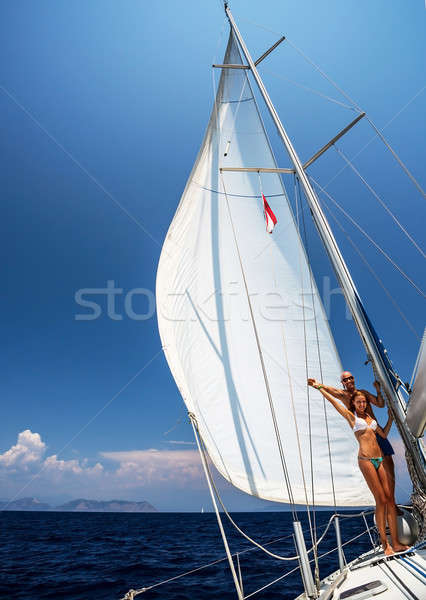 Feliz casal velejar barco veleiro jovem Foto stock © Anna_Om