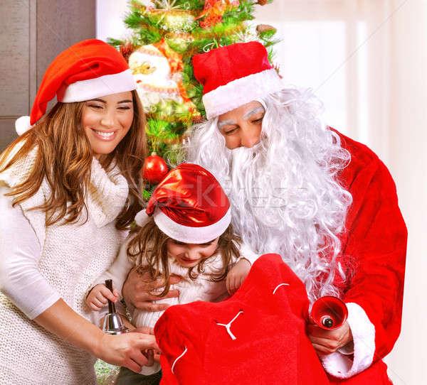 Happy family on Christmas eve Stock photo © Anna_Om