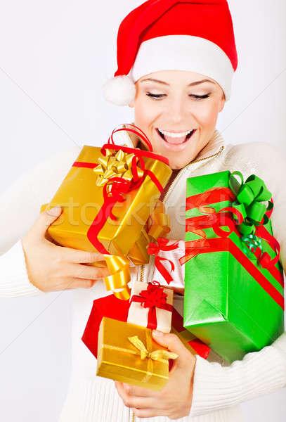 Happy Santa girl holding gifts Stock photo © Anna_Om