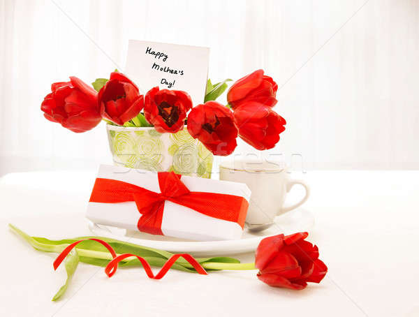 Tulips bouquet and coffee cup Stock photo © Anna_Om