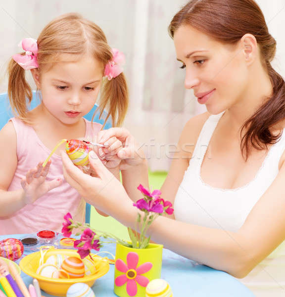 Baby girl with mother paint Easter eggs Stock photo © Anna_Om
