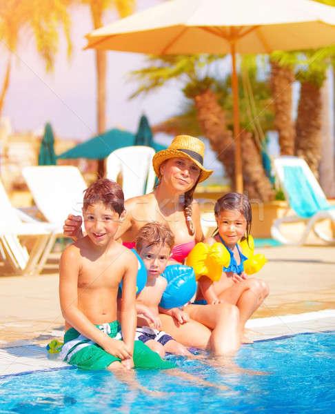 Big family near poolside Stock photo © Anna_Om