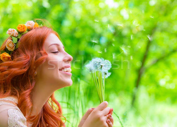 Stock photo: Cheerful female with dandelions