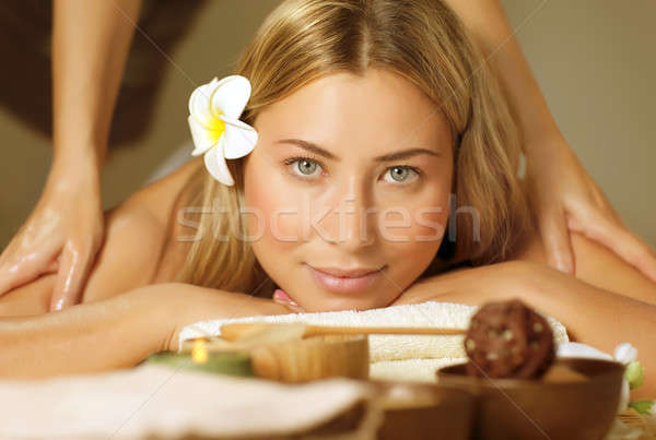 Beautiful woman on massage table Stock photo © Anna_Om