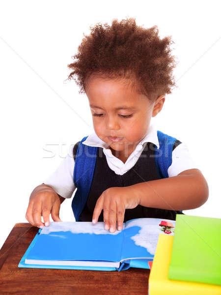 Kicsi fekete fiú olvas könyvek portré Stock fotó © Anna_Om