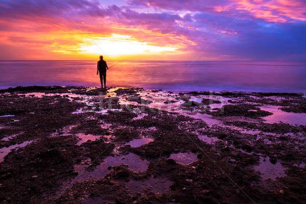 Сток-фото: силуэта · рыбак · закат · удивительный · красочный · свет