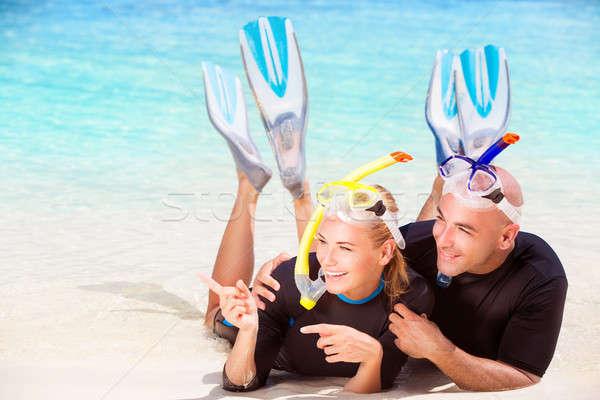 örömteli búvár pár fekszik tengerpart visel Stock fotó © Anna_Om