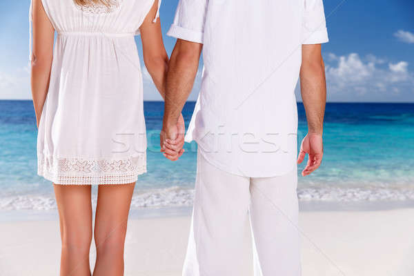 Young couple on the beach Stock photo © Anna_Om