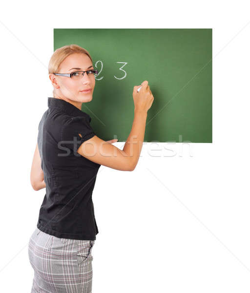 Teacher writting on chalkboard Stock photo © Anna_Om