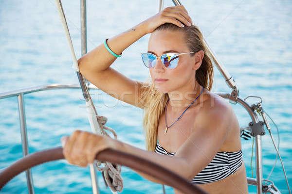 Beautiful woman on sailboat Stock photo © Anna_Om