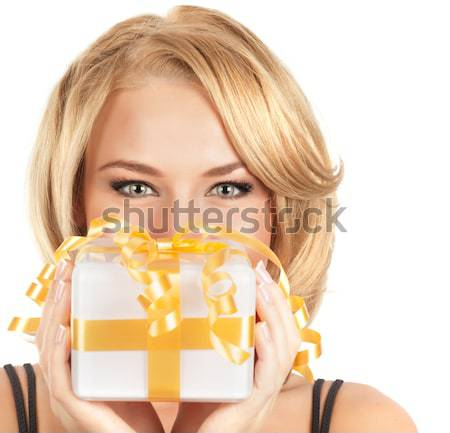 Stock photo: Beautiful female holding gift box