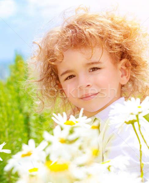 Kicsi fiú százszorszép legelő közelkép portré Stock fotó © Anna_Om