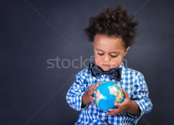 Feliz pré-escolar mundo africano menino olhando Foto stock © Anna_Om