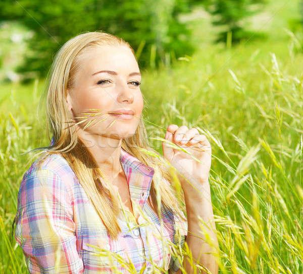 Aranyos lány búzamező szőke nő ül Stock fotó © Anna_Om