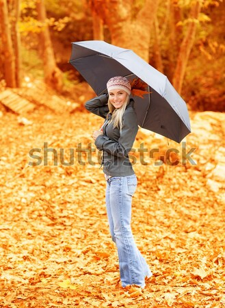 Girl with umbrella in autumn park Stock photo © Anna_Om