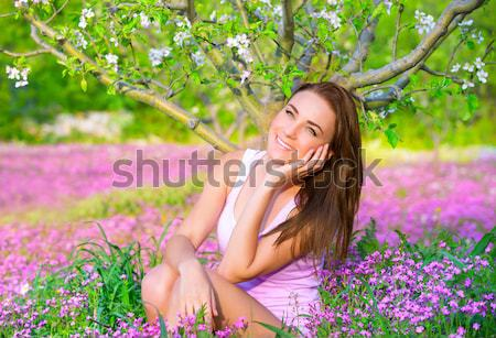 Dreamy woman in blooming park Stock photo © Anna_Om