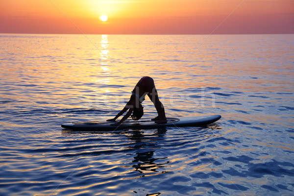 Yoga spiaggia femminile esercizio bella tramonto Foto d'archivio © Anna_Om
