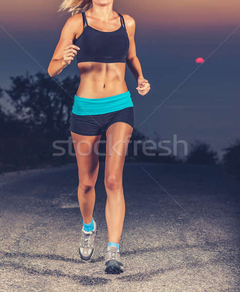 Stock photo: Athletic woman jogging outdoors