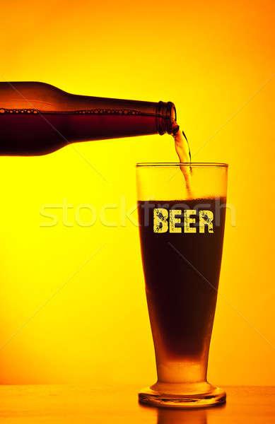 Waiter pouring dark beer Stock photo © Anna_Om