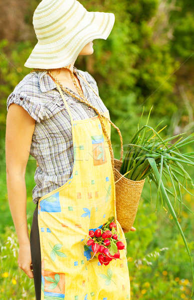 Happy woman gardener working Stock photo © Anna_Om