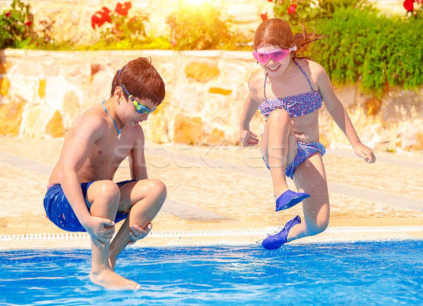 Happy children in the pool Stock photo © Anna_Om