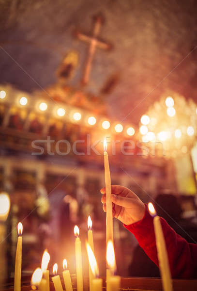 Child puts a candle in the church Stock photo © Anna_Om