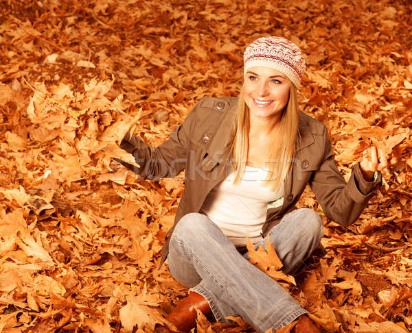 Girl throwing up autumnal leaves Stock photo © Anna_Om