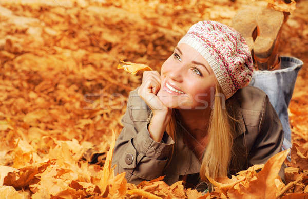 Cheerful teen on fall foliage Stock photo © Anna_Om