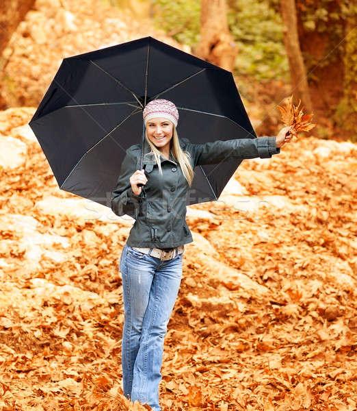 красивая женщина зонтик фото женщину ходьбы дождливый Сток-фото © Anna_Om