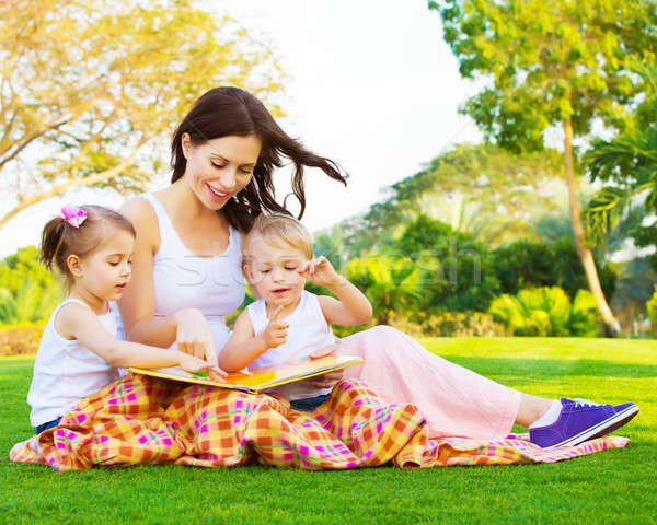 Woman with daughter and son read fairytale Stock photo © Anna_Om