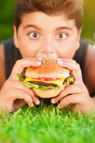 Hungry boy eating burger Stock photo © Anna_Om