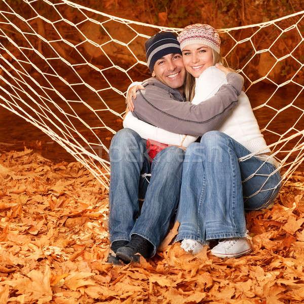 Fiatal család ölel függőágy kép boldog Stock fotó © Anna_Om