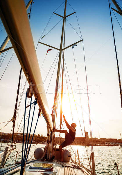 Young sailor on sailboat Stock photo © Anna_Om