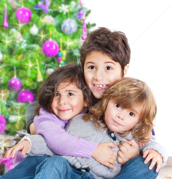 Happy kids near Christmas tree Stock photo © Anna_Om