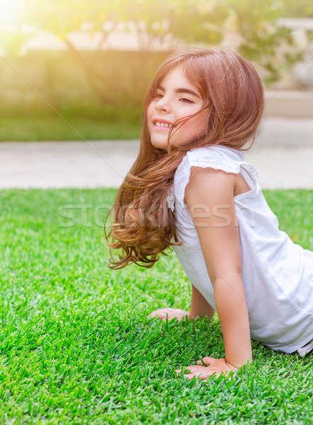Little girl doing push-ups outdoors Stock photo © Anna_Om