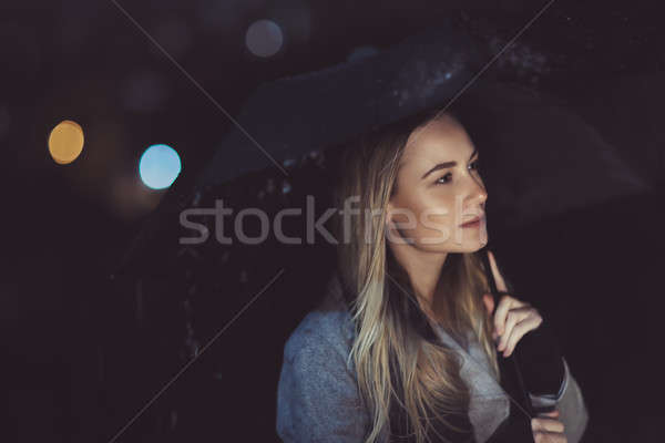 Pensive woman outdoors in rainy night Stock photo © Anna_Om