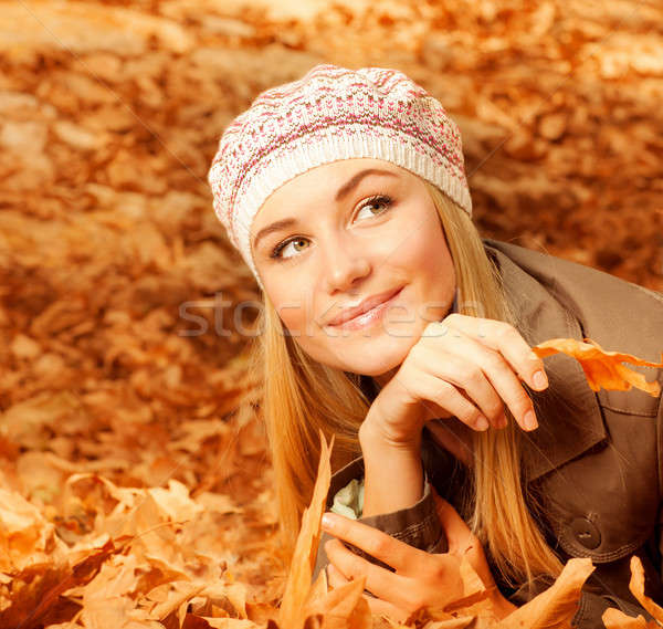 Pretty woman on autumnal leaves Stock photo © Anna_Om