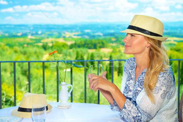 Stock photo: Traveler girl in outdoors cafe