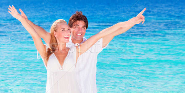 Happy couple playing on the beach Stock photo © Anna_Om