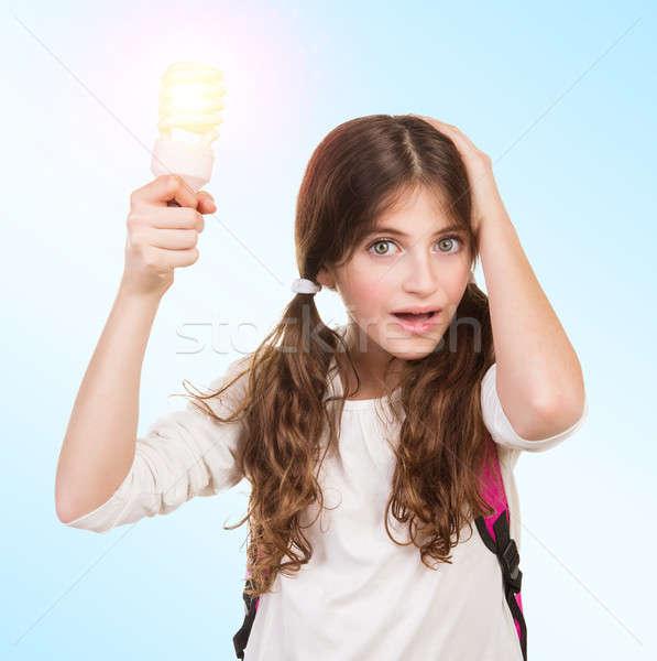 Shocked schoolgirl with lamp Stock photo © Anna_Om
