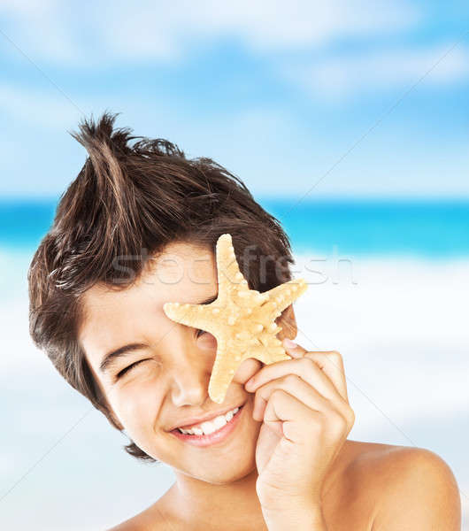 Happy face boy with starfish on the beach Stock photo © Anna_Om