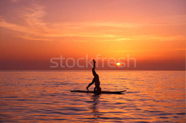 Stock photo: Yoga teacher on the beach