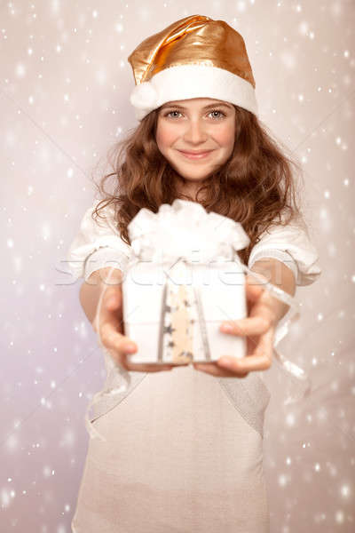 Santa girl offers gift box Stock photo © Anna_Om