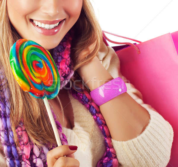 Woman eating sweet candy Stock photo © Anna_Om