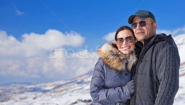 Happy travelers in snowy mountains Stock photo © Anna_Om