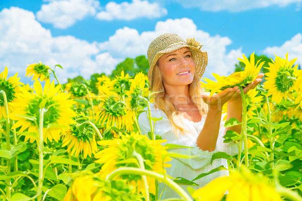 Stock photo: Cute girl in sunflower field