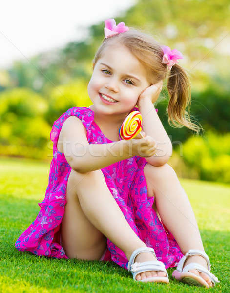 Little girl with lollipop Stock photo © Anna_Om