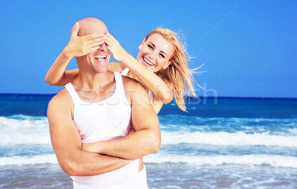 Stock fotó: Boldog · pár · szórakozás · tengerpart · fiatal · új