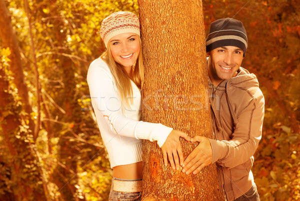 Happy lovers in autumn forest Stock photo © Anna_Om