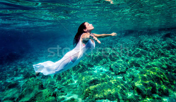 Beautiful woman relaxing in the water Stock photo © Anna_Om